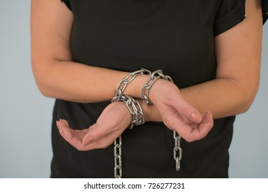woman chain bound hands