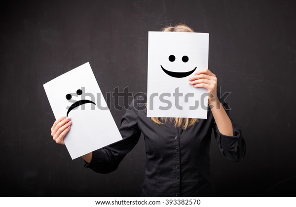 Woman changing smileys on her face