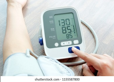 Woman check blood pressure monitor and heart rate monitor with digital pressure gauge. Health care and  Medical concept