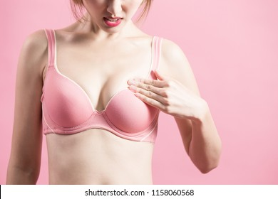 woman check her chest with prevention breast cancer concept