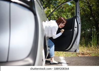 Woman checking for car scratches