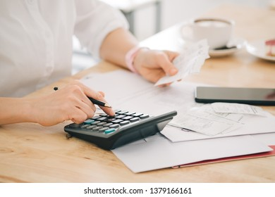woman is checking credit card bill information