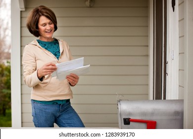 A woman checking her mailbox.