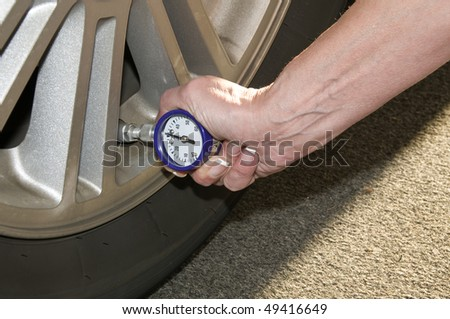 Woman Checking Her Tire Pressure Help Stock Photo (Edit Now