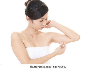 Woman checking her upper arm