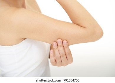 Woman checking her upper arm.