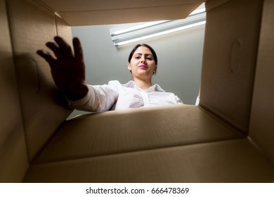 woman checking inside of box.