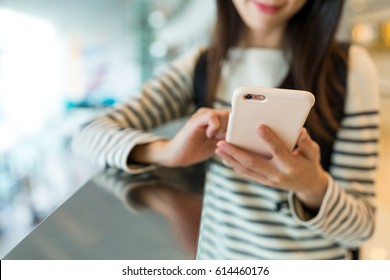 Woman checking something on mobile phone