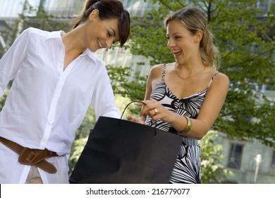 Woman checking their shopping bags.