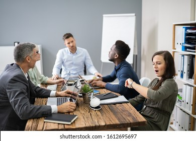 Woman Checking Time While Sitting In A Boring Long Meeting