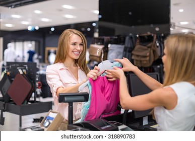Woman at the checkout makes shopping