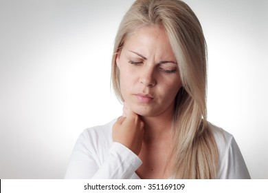 Woman checks fever with hand on neck
