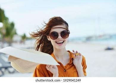woman cheerful woman wearing sunglasses travel island tourism
