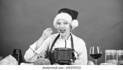 Woman chef santa hat cooking hold wooden spoons. Best christmas recipes. Christmas dinner idea. Cooking for family. Try main meal. Healthy christmas holiday recipes. Easy ideas for christmas party.