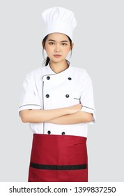 woman chef with chef uniform on grey background