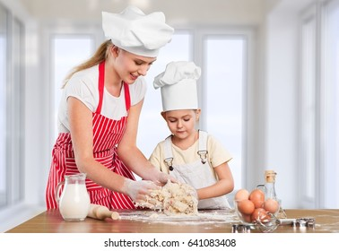 Woman and child coocking.