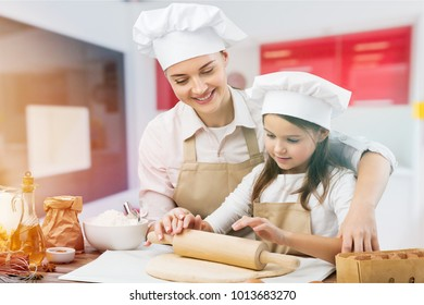 Woman and child cooking