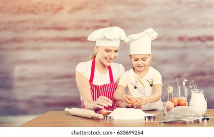 Woman and child cooking.