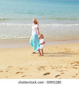 Woman and child go to the beach