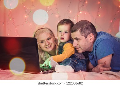 woman child and man on background from garland with laptop