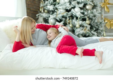 A woman with a child on Christmas