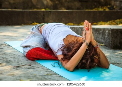 woman in childe pose balasana outdoor autumn day