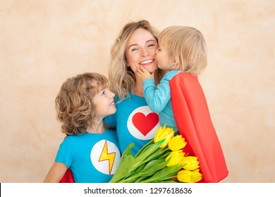 woman and children at home. Mother, daughter and son having fun together. Spring family holiday concept. Mother's day