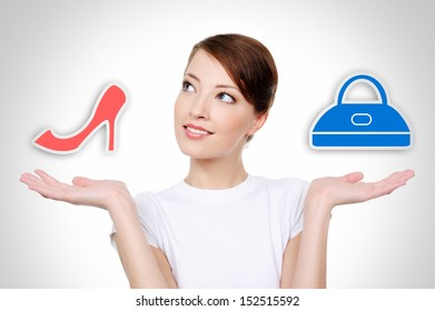 Woman choice between two things - shopping concept