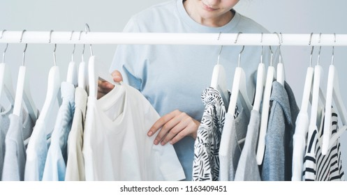 Woman choosing clothes on a rack