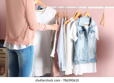 Woman choosing clothes on rack in dressing room