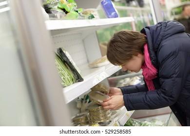 Woman choosing the food in a market