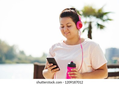 Woman choosing playlist for morning running