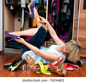 woman choosing shoes in front of the closet