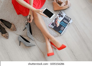 Woman choosing shoes indoors. Stylish wardrobe