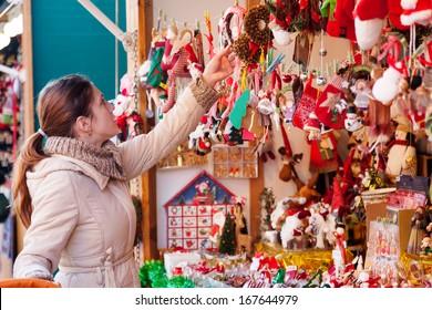 Woman choosing toys at Christmas market