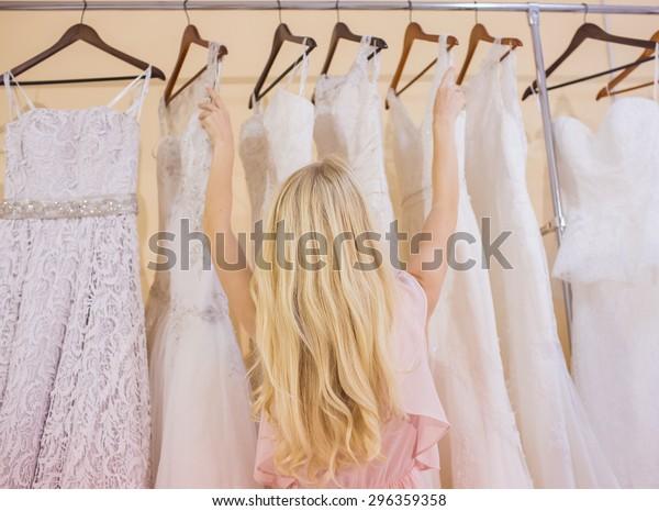 woman is choosing a wedding dress in the shop