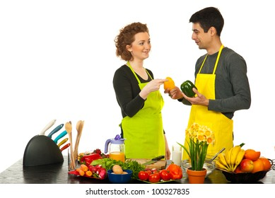 Woman chosen green pepper from husband hands isolated on white background