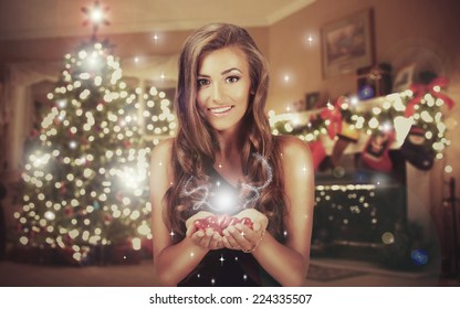 Woman with a Christmas Gift on the Christmas interior background