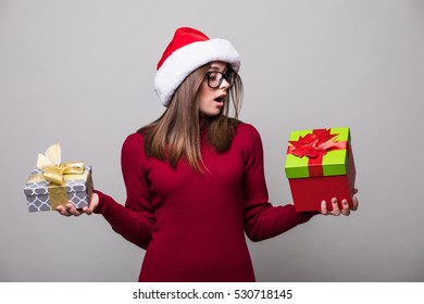Woman with Christmas hat hold two christmas gift