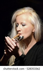 woman with cigar in loft