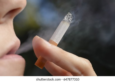 Woman with Cigarette Exhaling Smoke.