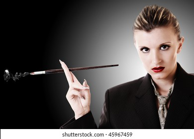 Woman with cigarette holder in office suite