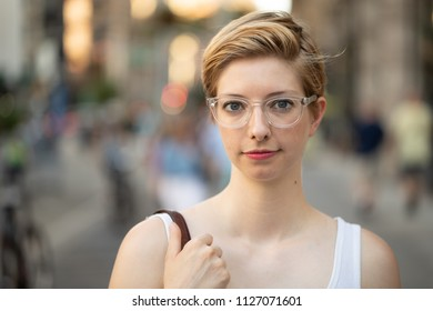 Woman in city serious face