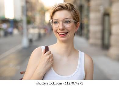 Woman in city walking street talking on cell phone