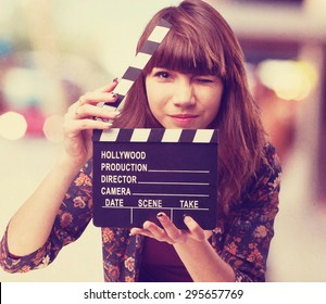 woman with clapper