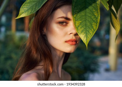 woman clean skin cosmetology model green palm leaves natural look