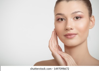 woman with clean skin touches her cheeks with her hand. facial skin concept on