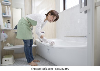 A woman cleaning a bath