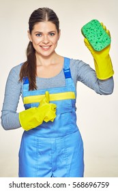 Woman cleaning company worker holding equipment for cleaning housework. Toothy smiling woman isolated portrait.