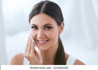 Woman Cleaning Face With Facial Cleansing Wipes, Removing Makeup